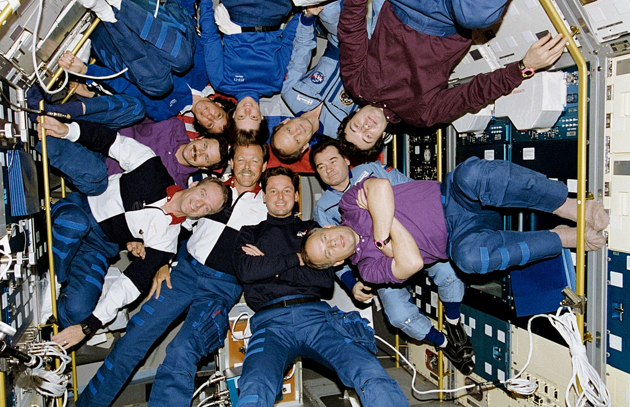 Ten people inside Spacelab Module in the Shuttle bay in June 1995