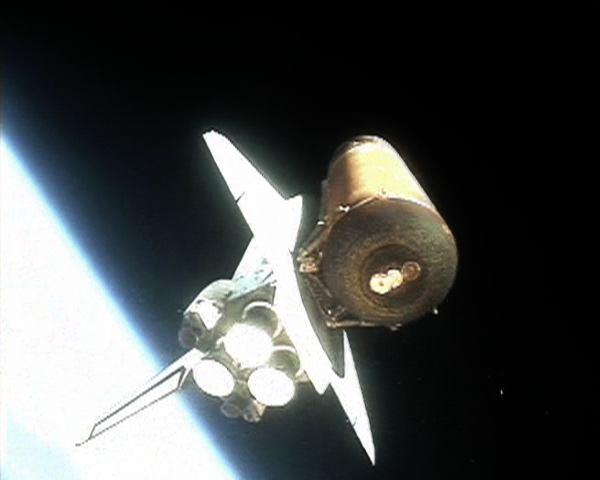 Discovery rockets into orbit, seen here just after solid rocket booster (SRB) separation