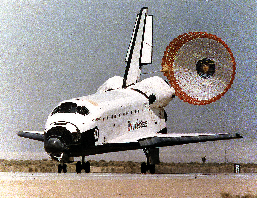 A drag chute is deployed by Endeavour as it completes a mission of almost 17 days in space on Runway 22 at Edwards Air Force Base in southern California.