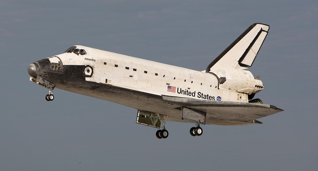 Atlantis's landing gear are deployed following STS-122