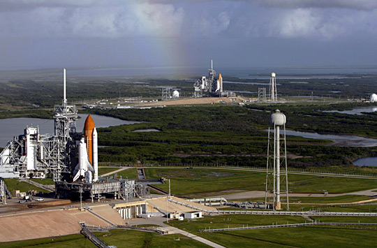 Atlantis and Endeavour on launch pads.