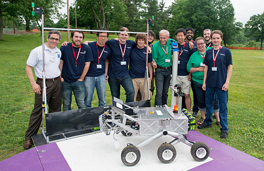 The West Virginia University Mountaineers pose with their robot, Cataglyphis, and officials at the 2014 NASA Centennial Challenges Sample Return Robot Challenge at Worcester Polytechnic Institute in Worcester, Mass., after completing Level 1 for a prize of $5,000. A year later, the team won the $100,000 Level-2 Prize. In 2016, Team Mountaineers won the final challenge with a $750,000 prize (NASA/Joel Kowsky)
