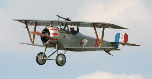 Replica Nieuport 23 flying with Lafayette Escadrille insignia.