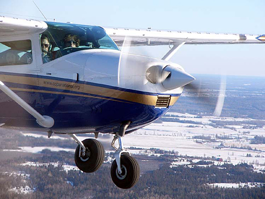 1967 Model Cessna 182K in flight showing after-market vortex generators on the wing leading edge