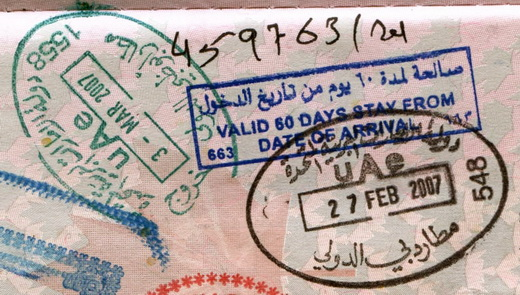 Passport entry stamp from Dubai International Airport (right in black ink). Exit stamp is from Abu Dhabi International Airport.