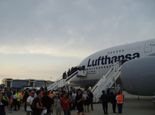 Lufthansa's first A380 making a special visit, with the main terminal in the background