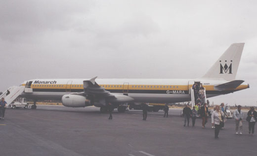 Passengers leaving an Airbus A321 of Monarch Airlines on a charter flight from Manchester at Menara airport in 2000