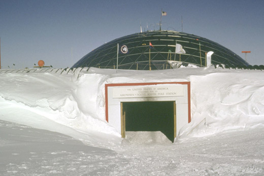 The main entrance to the former geodesic dome ramps down from the surface level. The base of the dome base was originally at the surface level of the ice cap, but the base had been slowly buried by snow and ice.