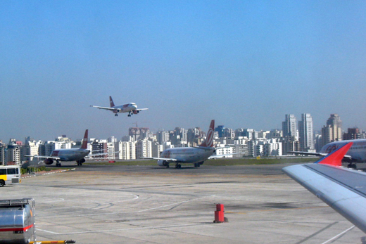 Airplanes waiting in line for take off at the congested Congonhas Airport.