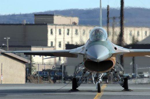 An F-16 Fighting Falcon aircraft from Nellis Air Force Base's 64th Aggressor Squadron prepares to take off from Eielson Air Force Base.