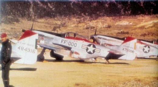 North American F-51D-25-NT Mustangs of the 67th Fighter-Bomber Squadron (18th FBG). AF Serial No. 44-84916 and 44-75000 identifiable.