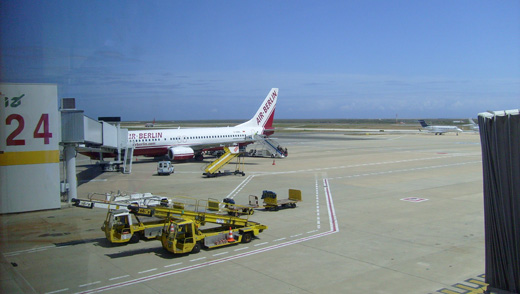 an Air Berlin Boeing 737-800 at Gate 24.