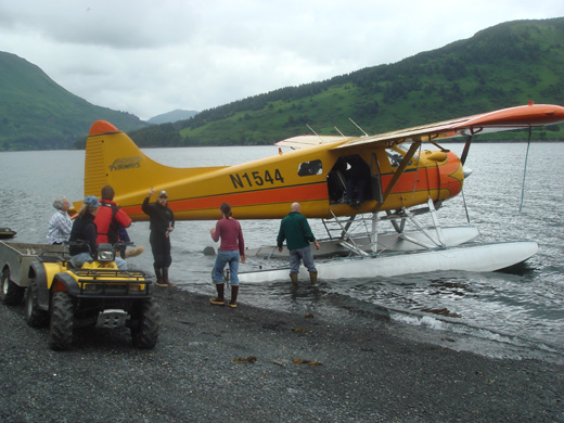 A De Haviland Beaver, part of the Andrew's Airways fleet dropping off tourists at a remote lodge on Raspberry Island (Alaska)