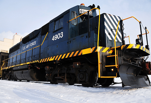 A U.S. Air Force EMD GP40-2 locomotive sits outside Eielson AFB's central heat and power plant. The base owns two of these engines, both moving coal & rail traffic across the 11 mi (18 km) rail system, making it the second largest railroad in Alaska.