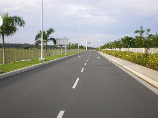 A secondary access road leading to the airport complex. This road branches from the main access road leading to the airport.