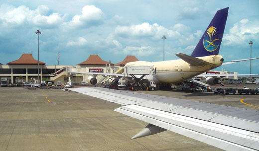 On the apron, Saudi Airlines Boeing 747 refueling and reloading to serve Indonesian Hajj pilgrims to Mecca.