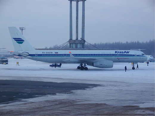 A Kras Air Tu-204 on stand at Pulkovo in winter