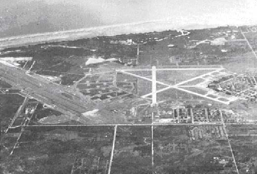 Oblique westward oriented photo of MacDill Airfield taken during World War II.