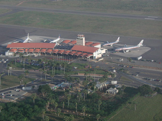 Full ramps at Cibao Airport in the morning with flight to New York, Newark and Miami in 2003