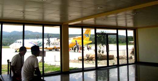 Passengers boarding a plane, viewed from the Arrival Area