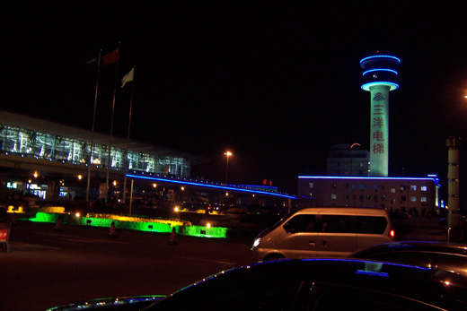 Like the city itself, colorful neon greets airport visitors at night.