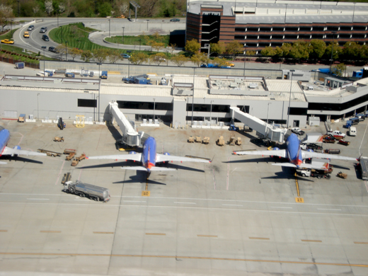 Southwest Airlines Boeing 737 aircraft parked at Terminal A with parking structure behind