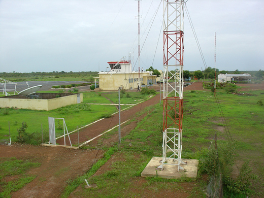 Airport telecommunication antennas and towers, with terminal in background, 2006.
