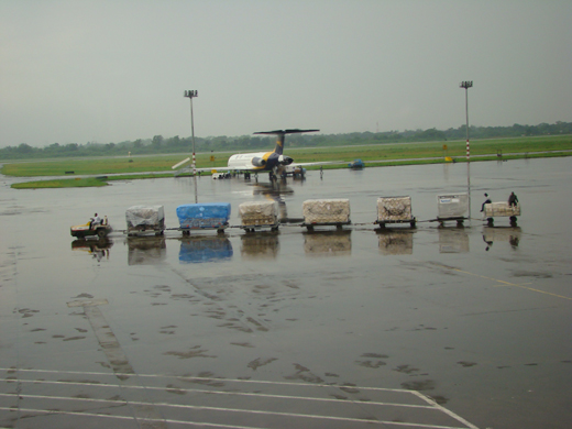 A GMG airlines aircraft waits at the runway on a rainy day.