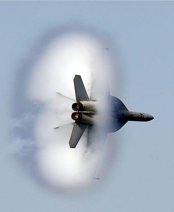 A United States Navy F/A-18E/F Super Hornet in transonic flight.