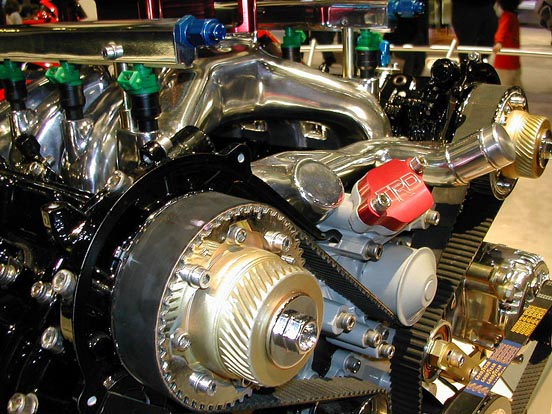 An automobile engine partly opened and colored to show components