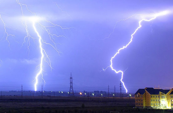 Lightning is the electric breakdown of air by strong electric fields and is a flow of energy. The electric potential energy in the atmosphere changes into heat, light and sound which are other forms of energy.
