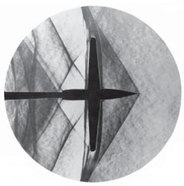 A schlieren photograph showing the compression in front of an unswept wing at Mach 1.2