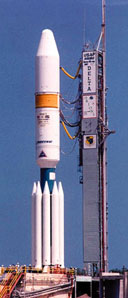 A two-stage Delta III with nine solid rocket boosters attached.