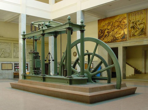 The Watt steam engine, a major driver in the industrial revolution, underscores the importance of engineering in modern history. This model is on display at the main building of the ETSIIM in Madrid, Spain