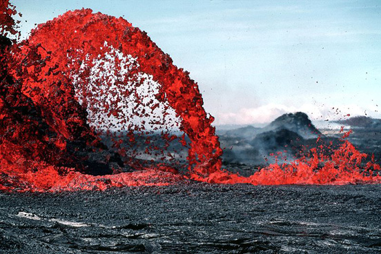 This parabola-shaped lava flow illustrates Galileo's law of falling bodies as well as blackbody radiation – the temperature is discernible from the color of the blackbody.