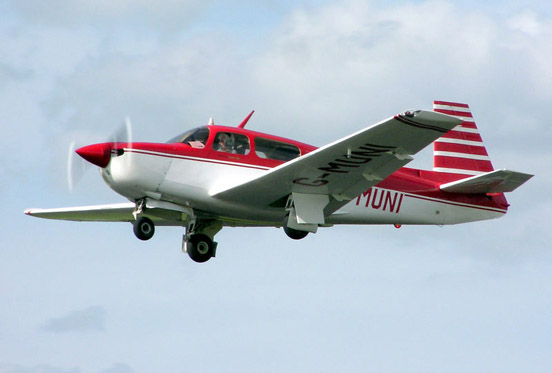 A Mooney M20J with tricycle landing gear.