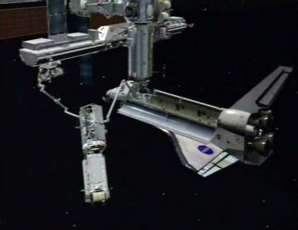 3D computer rendering of the CANADARM on Atlantis handing the P3/P4 Truss segment to the Canadarm2 on the International Space Station during STS-115.