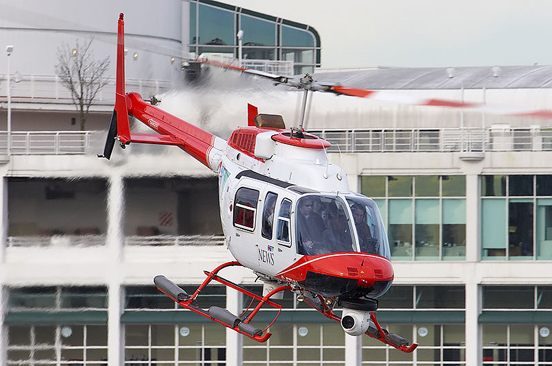 Bell 206L-4 Long Ranger IV (operated by CTV British Columbia), taking off from Vancouver Harbour helipad.