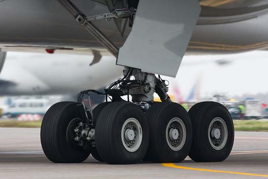 The six-wheel undercarriage of a Boeing 777-300