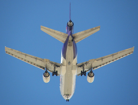 In 2006, FedEx became the first U.S. carrier to equip its aircraft with an anti-missile defense system. The gray oval Northrop Grumman Guardian pod can be seen on the belly of this FedEx MD-10 between and just aft of the main landing gear.