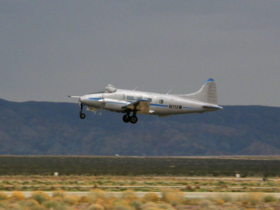 Dove 6A belonging to the National Test Pilot School departs the Mojave Airport