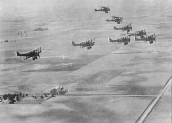 A formation of DH-4s in flight.