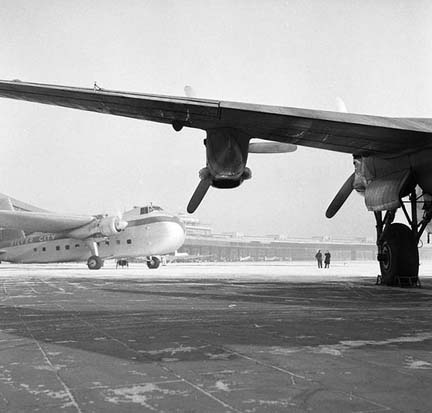 A Silver City Airways Bristol Freighter viewed from under the wing of an Avro York at Berlin-Tempelhof, 1954.