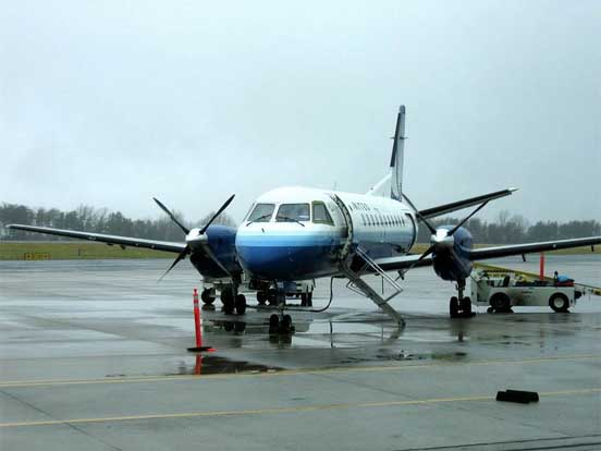 A Colgan Air / United Express Saab 340 prepares to accept passengers. Charlottesville-Albemarle Airport, 2005.