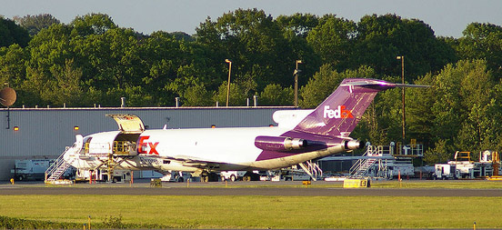 A FedEx 727 at PWM with cargo doors open.