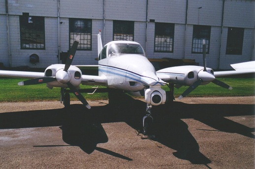 Cessna T310P equipped with a nose-mounted IR detection system for forest fire detection.