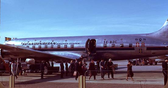 Passengers deplaning an SAS DC-6. Note the upper row of windows, indicating this was built as the optional sleeper variant of the original length DC-6