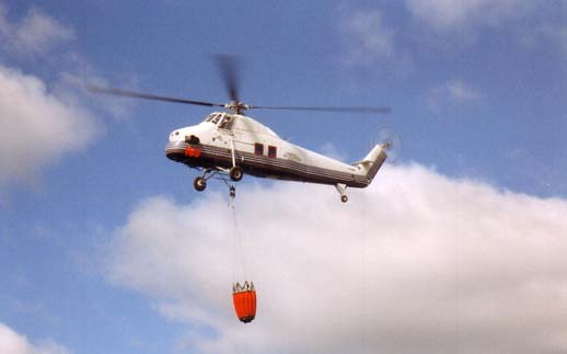 Civil S-58T fire fighting with a Bambi bucket