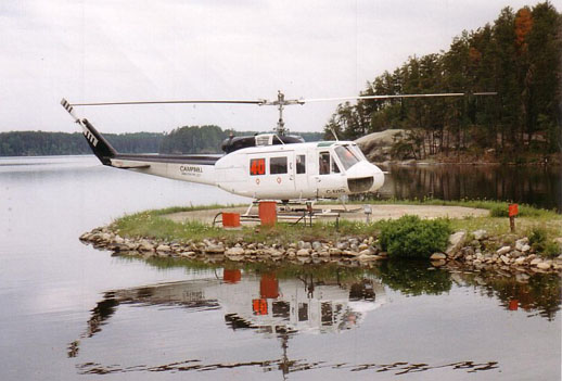 A Bell 205A-1 on firefighting duty with the Ontario Ministry of Natural Resources at Nym Lake, ON, 1996