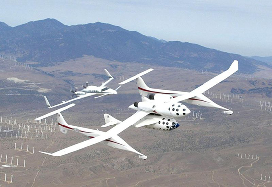 A Beechcraft Starship chasing a Scaled Composites SpaceShipOne during a test flight